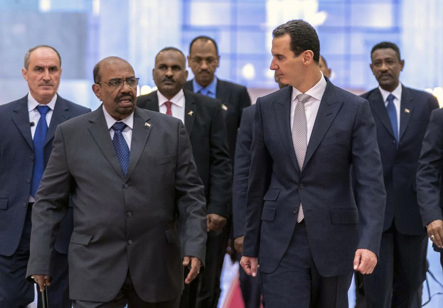 FILE - In this file photo released by the Syrian official news agency SANA on Dec. 16, 2018, Syrian President Bashar Assad, right, meets with Sudan's President Omar Bashir in Damascus, Syria. Assad is the last man standing among a crop of Arab dictators after the fall of the Sudanese and Algerian leaders. He's survived an 8-year war to topple him and an Islamic caliphate over part of his broken country. But Bashar Assad's path is strewn with difficulties and the war for Syria is far from over. (SANA via AP, File)