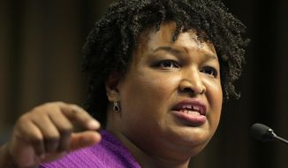 Former Georgia gubernatorial candidate Stacey Abrams speaks during the National Action Network Convention in New York, Wednesday, April 3, 2019. (AP Photo/Seth Wenig)