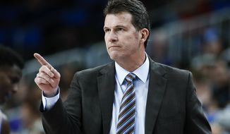 FILE - In this Dec. 31, 2017, file photo, UCLA coach Steve Alford gestures during the team's NCAA college basketball game against Washington in Los Angeles. Nevada hired former UCLA coach Alford on Thursday April 11, 2019, four days after Eric Musselman left for Arkansas. Alford is expected to be introduced at a Friday news conference. (AP Photo/Ringo H.W. Chiu, File)