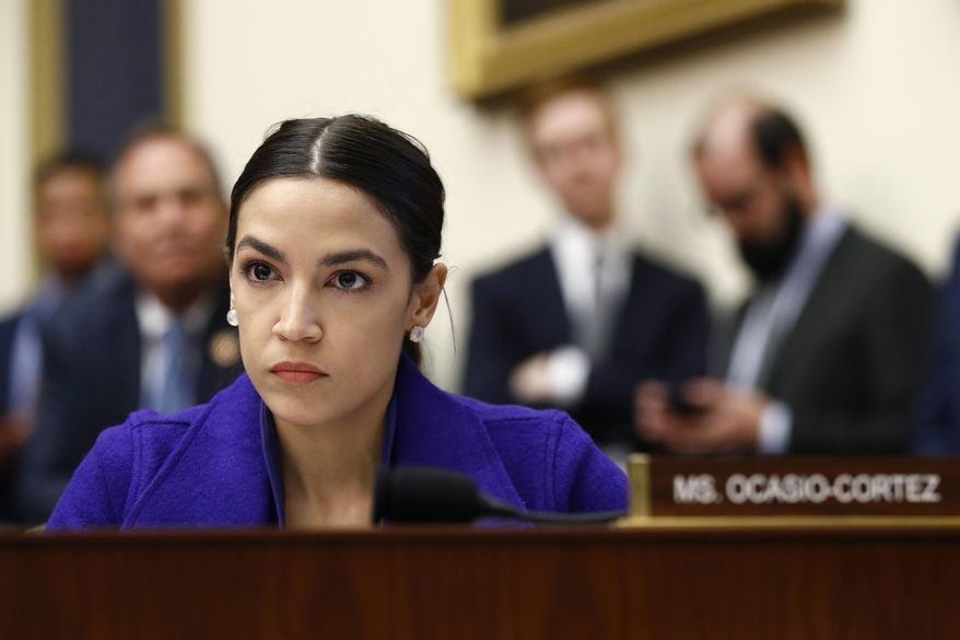 In this Wednesday, April 10, 2019, file photo, Rep. Alexandria Ocasio-Cortez, D-N.Y., listens during a House Financial Services Committee hearing with leaders of major banks on Capitol Hill in Washington. (AP Photo/Patrick Semansky, File)