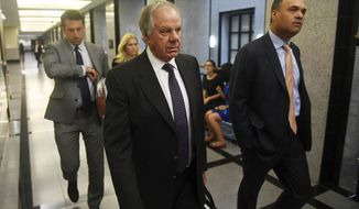 Attorneys Jack Goldberger, center, Alex Spiro, left, and William Burck, the defense team for New England Patriots owner Robert Kraft, make their way to Courtroom 2E at the Palm Beach County Courthouse, Friday, April 12, 2019, in West Palm Beach, Fla., for a status hearing in a prostitution case against Kraft. (Patrick Dove/TCPalm.com via AP, Pool)