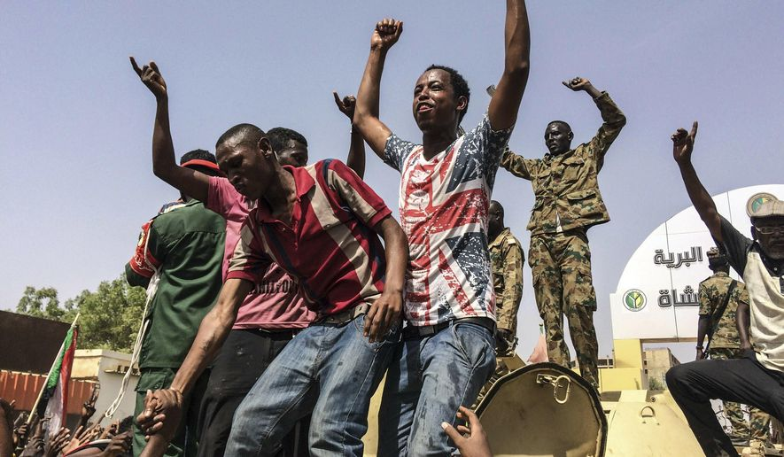 Sudanese celebrate after officials said the military had forced longtime autocratic President Omar al-Bashir to step down after 30 years in power in Khartoum, Sudan, Thursday, April 11, 2019. (AP Photo)