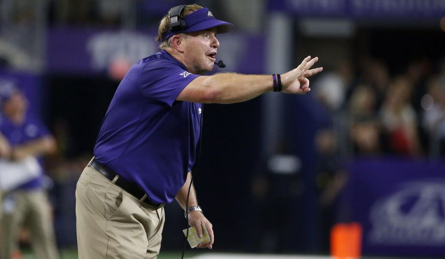 FILE - In this Sept. 15, 2018, file photo, TCU coach Gary Patterson directs his team against Ohio State during the first half of an NCAA college football game in Arlington, Texas. Patterson said TCU went through much of spring practice with only about half of an 85-player scholarship roster. That gap was created by injuries and about 20 spots that will be filled when the rest of the 2019 recruiting class and some graduate transfers arrive in the summer. (AP Photo/Michael Ainsworth, File)
