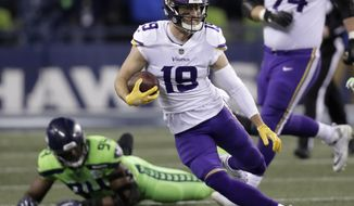 FILE - In this Dec. 10, 2018, file photo, Minnesota Vikings' Adam Thielen runs with the ball after a reception against the Seattle Seahawks in the second half of an NFL football game in Seattle. The Vikings and wide receiver Thielen have agreed in principle to a four-year contract extension valued at $64 million. The Vikings announced the deal Friday, April 12, 2019. (AP Photo/Stephen Brashear, File)