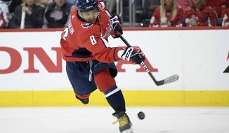 Washington Capitals left wing Alex Ovechkin (8), of Russia, shoots the puck during the second period of Game 2 of an NHL hockey first-round playoff series against the Carolina Hurricanes, Saturday, April 13, 2019, in Washington. (AP Photo/Nick Wass) ** FILE **