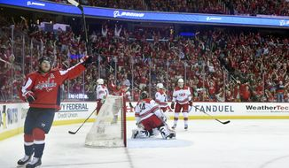 Washington Capitals center Nicklas Backstrom, left, of Sweden, celebrates his goal against Carolina Hurricanes goaltender Petr Mrazek (34) during the first period of Game 2 of an NHL hockey first-round playoff series, Saturday, April 13, 2019, in Washington. The Capitals won 4-3 in overtime. (AP Photo/Nick Wass)