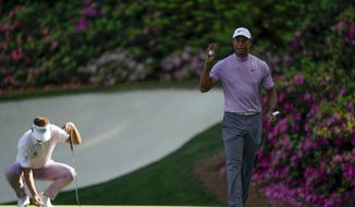 Tiger Woods waves on the 13th hole during the third round for the Masters golf tournament Saturday, April 13, 2019, in Augusta, Ga. (AP Photo/David J. Phillip)