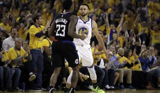 Golden State Warriors' Stephen Curry, right, celebrates a score while guarding Los Angeles Clippers' Lou Williams (23) in the first half in Game 1 of a first-round NBA basketball playoff series Saturday, April 13, 2019, in Oakland, Calif. (AP Photo/Ben Margot)
