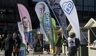 Different parties campaigning for parliamentary elections on the Narinkkatori Square in Helsinki, Finland, on Friday, April 12, 2019. The election day of the Finnish parliamentary elections is on Sunday, April 14, 2019. (Markku Ulander/Lehtikuva via AP)
