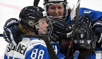 Goal scorer Finland's Ronja Savolainen, left, celebrates after scoring with teammates Rosa Lindstedt, Noora Tulus and Jenni Hiirikoski during the IIHF Women's Ice Hockey World Championships semifinal match between Canada and Finland in Espoo, Finland, Saturday, April 13, 2019. (Jussi Nukari/Lehtikuva via AP)