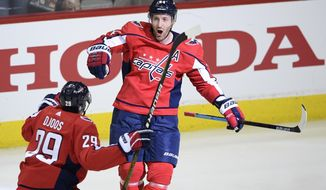 Washington Capitals defenseman Brooks Orpik (44) celebrates his game-winning goal with defenseman Christian Djoos (29), of Sweden, in overtime of Game 2 of an NHL hockey first-round playoff series against the Carolina Hurricanes, Saturday, April 13, 2019, in Washington. The Capitals won 4-3 in overtime. (AP Photo/Nick Wass) ** FILE **