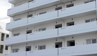 This photo shows an apartment where a U.S. servicemen and a Japanese woman found dead, in Chatan town, Okinawa, southwestern Japan Saturday, April 13, 2019. A U.S. serviceman has fatally stabbed a Japanese woman and then killed himself in Okinawa, according to the Japanese Foreign Ministry, amid growing resentment about the presence of American troops in Japan's southwestern region. (Kyodo News via AP)