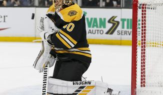 Boston Bruins goaltender Tuukka Rask (40) makes a save off his chest during the first period of Game 2 of an NHL hockey first-round playoff series against the Toronto Maple Leafs, Saturday, April 13, 2019, in Boston. (AP Photo/Mary Schwalm)