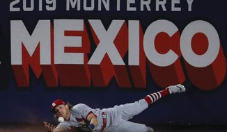 St. Louis Cardinals' Harrison Bader can't make the catch on a triple by Cincinnati Reds' Phillip Ervin during the eighth inning of a baseball game in Monterrey, Mexico, Saturday, April 13, 2019. The Reds defeated the Cardinals 5-2. (AP Photo/Rebecca Blackwell)