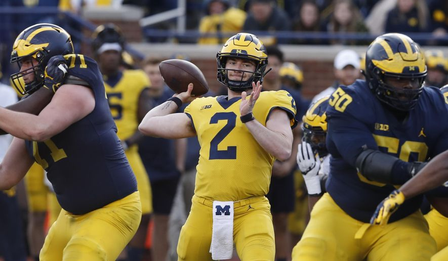 Michigan quarterback Shea Patterson (2) throws during the team's annual spring NCAA college football game, Saturday, April 13, 2019, in Ann Arbor, Mich. (AP Photo/Carlos Osorio)
