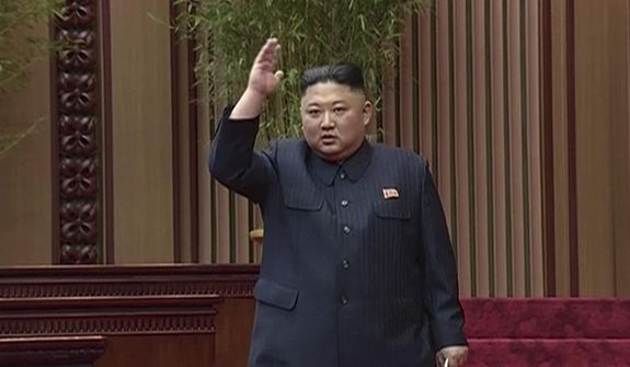 In this image made from a video taken on Friday, April 12, 2019, by North Korean broadcaster KRT, North Korean leader Kim Jong-un gestures to applauding audience after his speech at parliament in Pyongyang, North Korea. (KRT via AP)