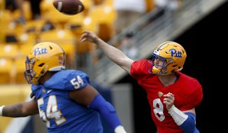 Pittsburgh quarterback Kenny Pickett (8) gets off a pass as offensive guard Rashad Wheelers looks to block during their annual intrasquad Blue-Gold spring NCAA college football game, Saturday, April 13, 2019, in Pittsburgh. (AP Photo/Keith Srakocic)