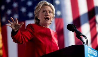 Democratic presidential candidate Hillary Clinton speaks at a rally at the Cathedral of Learning at the University of Pittsburgh in Pittsburgh, Pa., Monday, Nov. 7, 2016. (AP Photo/Andrew Harnik) ** FILE **