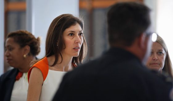 Former FBI lawyer Lisa Page, left, arrives for a closed-door interview with the House Judiciary and House Oversight committees, Monday, July 16, 2018, on Capitol Hill in Washington. (AP Photo/Jacquelyn Martin) ** FILE **