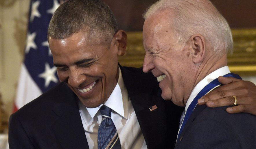 President Barack Obama laughs with Vice President Joe Biden during a ceremony in the State Dining Room of the White House in Washington, Thursday, Jan. 12, 2017. Obama presented Biden with the Presidential Medal of Freedom. (AP Photo/Susan Walsh)