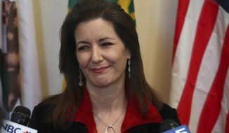 Oakland Mayor Libby Schaaf smiles during a media conference on Wednesday, March 7, 2018, in Oakland, Calif. (AP Photo/Ben Margot)