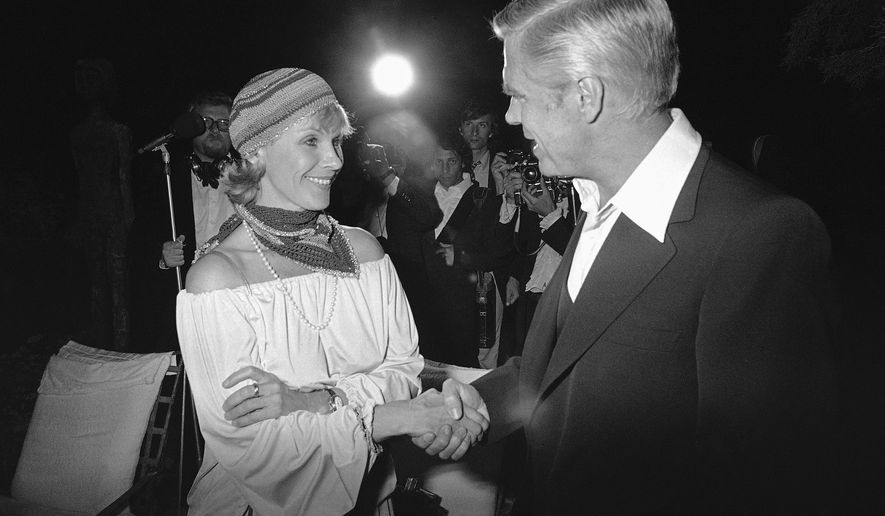 "Swedish actress Bibi Andersson meets U.S. actor director producer George Peppard at a party for the announcement of start of new U.S. film ""Cabo Blanco,"" May 25, 1978. (AP Photo/Jean-Jacques Levy)"