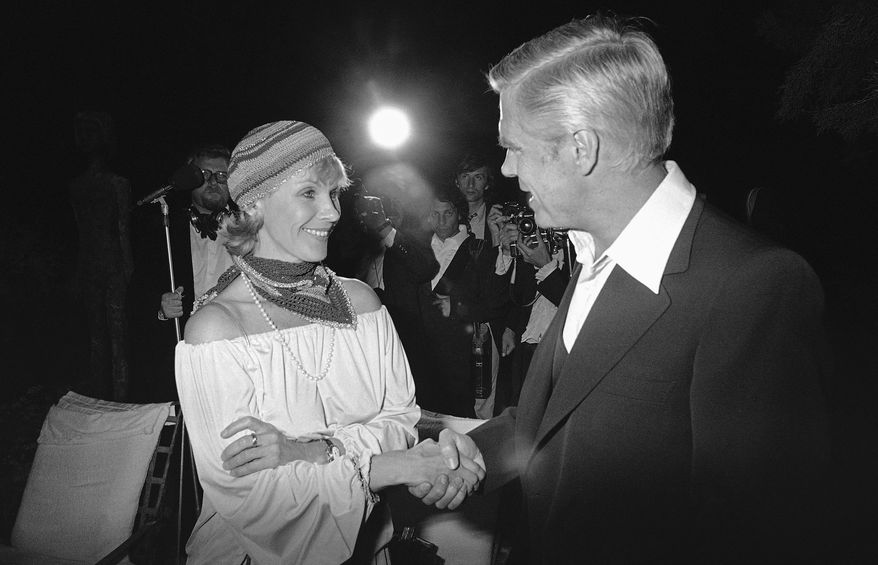 """Swedish actress Bibi Andersson meets U.S. actor director producer George Peppard at a party for the announcement of start of new U.S. film """"Cabo Blanco,"""" May 25, 1978. (AP Photo/Jean-Jacques Levy)"""