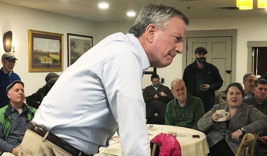 This March 17, 2019, file photo shows New York Mayor Bill de Blasio listening as he speaks before a group of people at a restaurant in Concord, N.H. A would-be progressive standard bearer, de Blasio has spent the past few months exploring a run, traveling to events in early primary states. (AP Photo/Hunter Woodall) ** FILE **