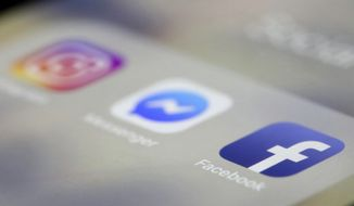 FILE- In this March 13, 2019, file photo Facebook, Messenger and Instagram apps are are displayed on an iPhone in New York. Facebook, Instagram and WhatsApp were temporarily down early Sunday, April 14. All three social media platforms, including Facebook Messenger, were affected by the outage. (AP Photo/Jenny Kane, File)