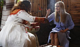 Kidist Birhanu, left, invites White House senior adviser Ivanka Trump to smell the coffee during a coffee ceremony at Dumerso Coffee, Sunday April 14, 2019, in Addis Ababa, Ethiopia. (AP Photo/Jacquelyn Martin)