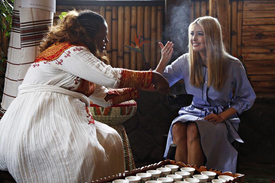 Kidist Birhanu, left, invites White House senior adviser Ivanka Trump to smell the coffee during a coffee ceremony at Dumerso Coffee, Sunday April 14, 2019, in Addis Ababa, Ethiopia. (AP Photo/Jacquelyn Martin)