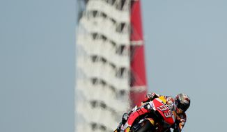 Marc Marquez (93), of Spain, steers through a turn during a warmup for the the Grand Prix of the Americas motorcycle race at the Circuit Of The Americas, Sunday, April 14, 2019, in Austin, Texas. (AP Photo/Eric Gay)