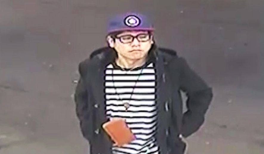 """This May 25, 2018 image from surveillance video released by the New South Wales Police Force shows Wachira """"Mario"""" Phetmang, 33, entering a service station in South Hurstville, a suburb of Sydney. Authorities have identified an American suspect in the killing of Phetmang, a Thai national whose battered body was found bound, gagged and wrapped in plastic on the side of a road in a high-profile case in Australia, according to a federal search warrant obtained Tuesday, April 9. 2019. (New South Wales Police via AP)"""