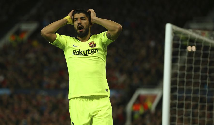 Barcelona's Luis Suarez reacts after missing an opportunity during the Champions League quarterfinal, first leg, soccer match between Manchester United and FC Barcelona at Old Trafford stadium in Manchester, England, Wednesday, April 10, 2019. (AP Photo/Dave Thompson)