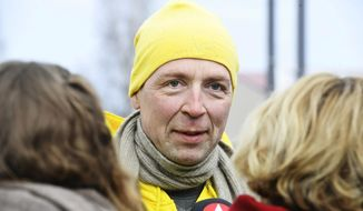 Chairman of the Finns Party Jussi Halla-aho campaigns for the Finnish parliamentary elections in Tuusula, Finland, Saturday, April 13, 2019, a day ahead of the elections. (Heikki Saukkomaa/Lehtikuva via AP)