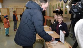 The chairman of the Finns Party and parliamentary candidate Jussi Halla-aho votes in the parliamentary elections, in Helsinki, Finland Sunday, April 14, 2019. Finns are voting in a parliamentary election in which reforming the nation's generous welfare model and tackling climate change have emerged as key issues.(Emmi Korhonen/Lehtikuva via AP)