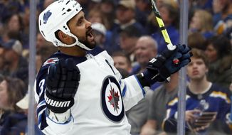 Winnipeg Jets' Dustin Byfuglien celebrates after scoring during the third period in Game 3 of an NHL first-round hockey playoff series against the St. Louis Blues Sunday, April 14, 2019, in St. Louis. The Jets won 6-3. (AP Photo/Jeff Roberson)
