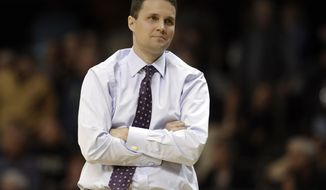 """FILE - In this Jan. 20, 2018, file photo, LSU coach Will Wade watches from the sideline during the second half of the team's NCAA college basketball game against Vanderbilt in Nashville, Tenn. LSU officials say their first meeting with suspended coach Wade has taken place but that there is not yet a resolution regarding Wade's long-term status. A written statement from the university says """"it is unlikely LSU makes any decisions today regarding Coach Wade."""" (AP Photo/Mark Humphrey, File)"""