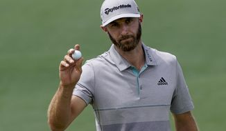 Dustin Johnson reacts on the second hole during the third round for the Masters golf tournament Saturday, April 13, 2019, in Augusta, Ga. (AP Photo/David J. Phillip)