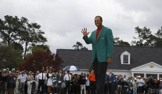 Tiger Woods wears his green jacket after winning the Masters golf tournament Sunday, April 14, 2019, in Augusta, Ga. (AP Photo/Matt Slocum) **FILE**