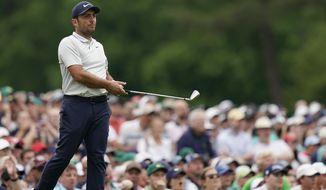 Francesco Molinari, of Italy, watches his shot go in the water on the 12th hole during the final round for the Masters golf tournament, Sunday, April 14, 2019, in Augusta, Ga. (AP Photo/David J. Phillip)