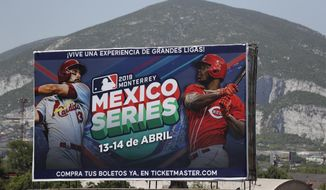 A billboard advertising the Mexico Series between the Cincinnati Reds and the St. Louis Cardinals stands outside the stadium before the start of their second game in Monterrey, Mexico, Sunday, April 14, 2019. (AP Photo/Rebecca Blackwell)