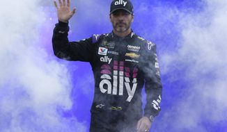 Jimmie Johnson waves to the crowd before the NASCAR Cup Series auto race at Richmond Raceway in Richmond, Va., Saturday, April 13, 2019. (AP Photo/Steve Helber)