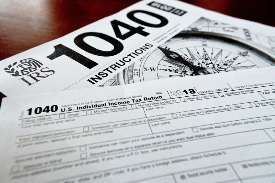 This Feb. 13, 2019, file photo shows multiple forms printed from the Internal Revenue Service web page that are used for 2018 U.S. federal tax returns in Zelienople, Pa. (AP Photo/Keith Srakocic, File)