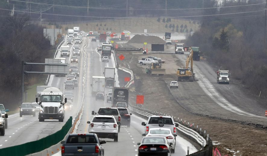 In a Friday, April 12, 2019, photo, Interstate Highway 75 construction continues in Troy, Mich. (AP Photo/Carlos Osorio)