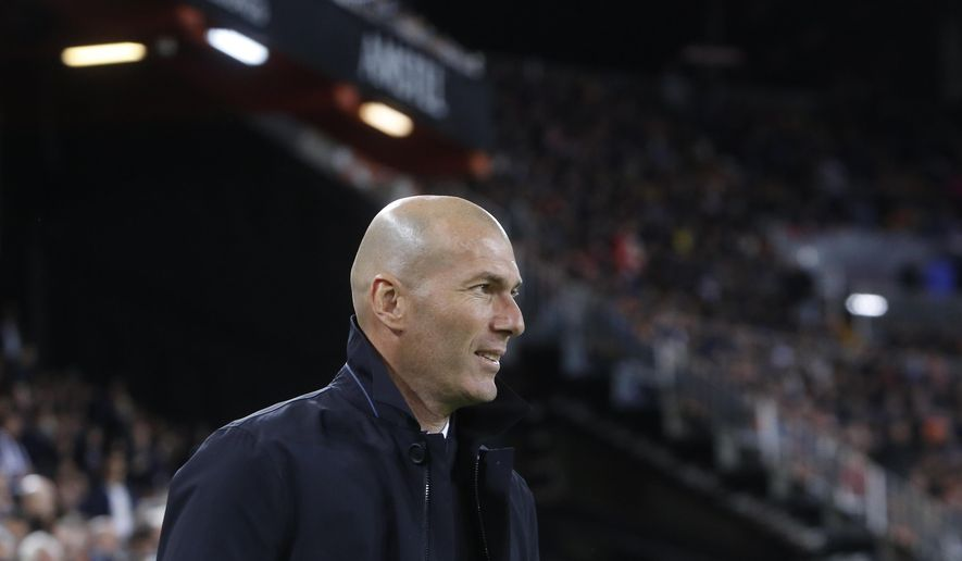 Real Madrid's coach Zinedine Zidane looks on prior of the Spanish La Liga soccer match between Valencia and Real Madrid at the Mestalla Stadium in Valencia, Spain, Wednesday, April 3, 2019. (AP Photo/Alberto Saiz)