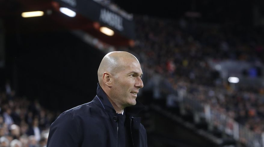 Real Madrid's coach Zinedine Zidane looks on prior of the Spanish La Liga soccer match between Valencia and Real Madrid at the Mestalla Stadium in Valencia, Spain, Wednesday, April 3, 2019. (AP Photo/Alberto Saiz)