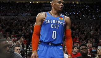 Oklahoma City Thunder guard Russell Westbrook interacts with the crowd during the first half of Game 1 of a first-round NBA basketball playoff series against the Portland Trail Blazers in Portland, Ore., Sunday, April 14, 2019. (AP Photo/Steve Dipaola)