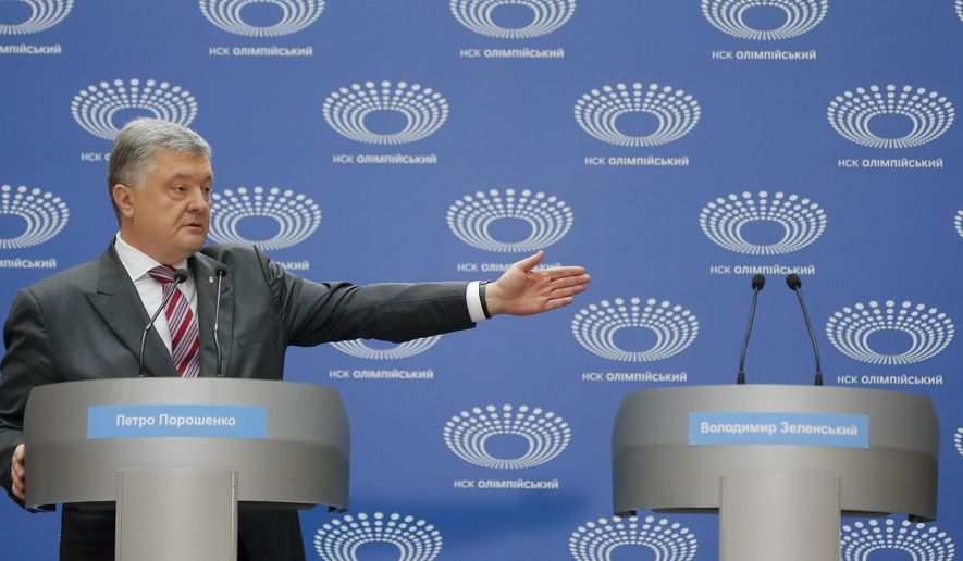 Ukrainian President Petro Poroshenko gestures as he answers to a journalist's question ahead of the presidential elections on April 21, at the Olympic stadium in Kiev, Ukraine, Sunday, April 14, 2019. The event Sunday was the latest unusual scene in the fight between Poroshenko and Zelenskiy, the comedian whom polls show holding a commanding lead. (AP Photo/Efrem Lukatsky)
