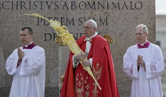 Pope Francis holds a palm frond as he celebrates a Palm Sunday Mass in St. Peter's Square at the Vatican, Sunday, April 14, 2019. (AP Photo/Gregorio Borgia)